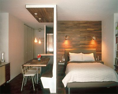 small space designs. Brilliant wood wall used to divide the space and create storage!!