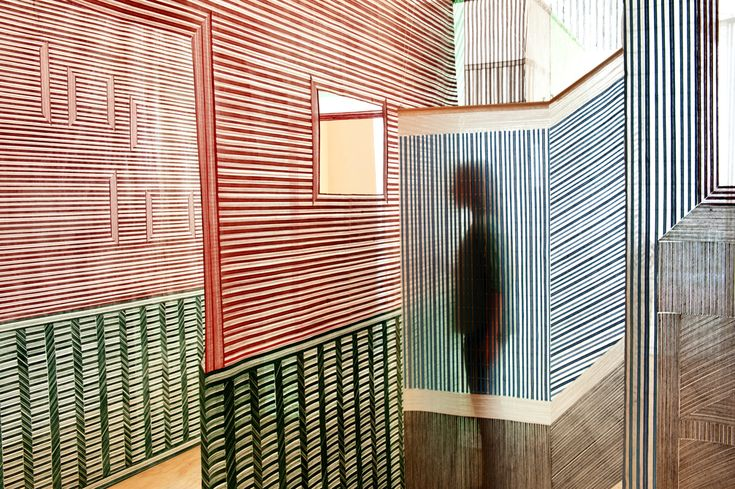 ~~Woven Walls is a hand woven installation by Dutch designer Wies Preijde.~~ Explorong some of the spaces created by the hanging pieces, she also utilizes patterns to create 3D optical illusions.'  Via Textile Arts Center blog.