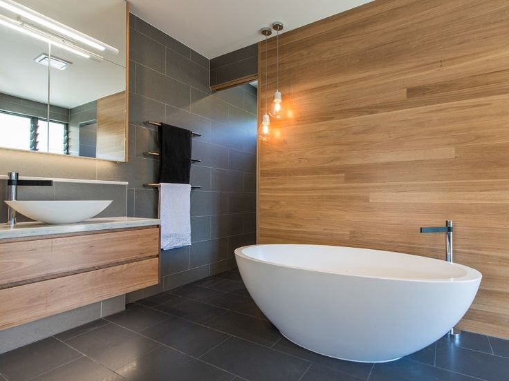 Gorgeous timber look in ensuite with bath