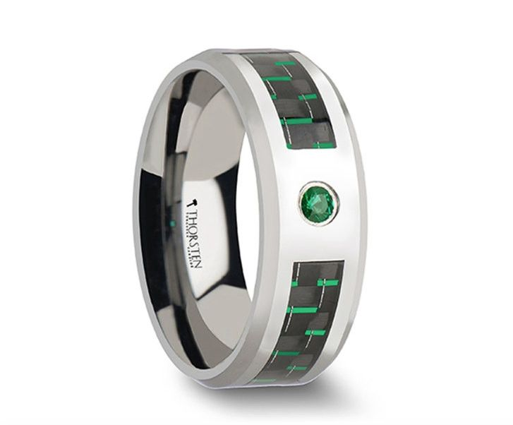 This awesome style from our tungsten wedding bands line incorporates the use of an emerald setting to add color. This comfort fit wedding band has a flat style design with polished beveled edges. The