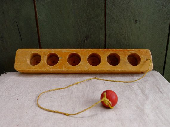 vintage handmade wooden ball on a string by nestingplacemarket