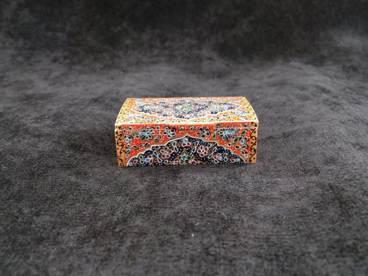 Item Details - Size: 7cm X4.5cm X 2.5cm (WXDXH) W=Width, D=Depth, H=Height - Weight: 70 gr - Material: Glazed Hand Painting on Camel Bone - Origination: Handmade in Isfahan / Persia (Iran) - Usage: Jewelry Box , Small Storage, Decorative Item, Persian Gift Shop @ persianhandicrafts.com