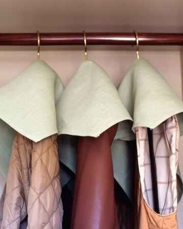 Cut a hole in a cloth napkin to make dust covers for coats and vests. | 37 Deep Cleaning Tips Every Obsessive Clean Freak Should Know
