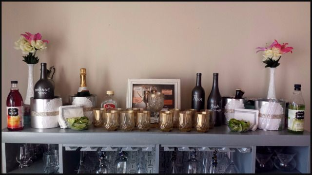 Gorgeous diy champagne cocktail bar. Art deco glasses in crystal and gold. Ingredients were put in wine bottles that were painted. Have a recipe list so guests know what drinks they can make with the mixers provided. 1920's or great gatsby theme.