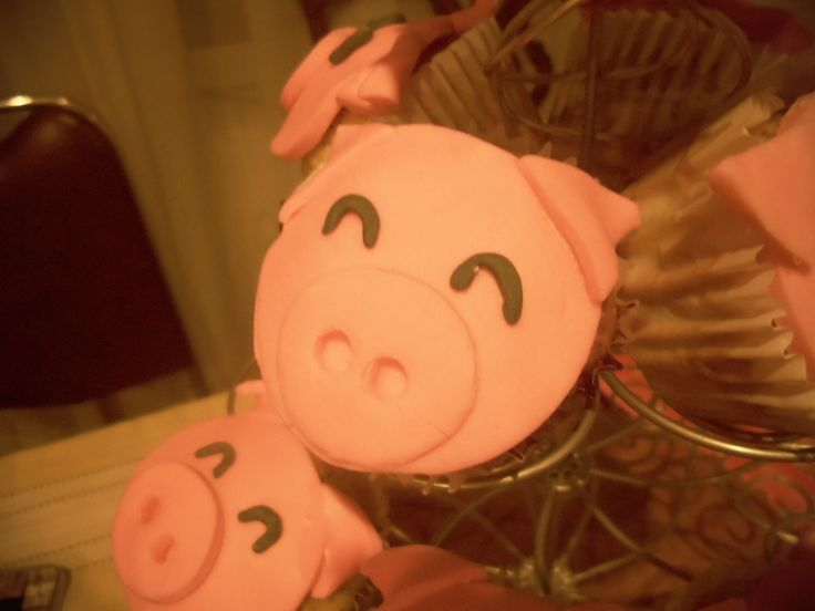Pig cupcakes, they are actually strawberry cupcakes and is totally eatable.