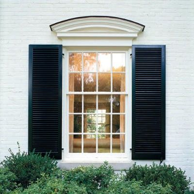 white painted brick + black shutters is a all time fav...Like molding above window
