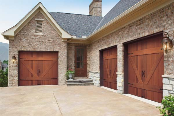 The 89 best images about clopay wood carriage house garage for Wood look garage doors