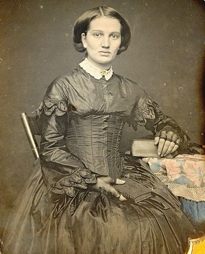 Civil War Era photograph of a beautiful lady seated beside a table