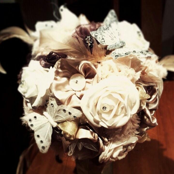 Fabric flower bouquet buttons, butterflies, feathers etc