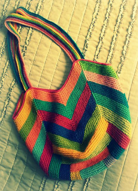 """Tulip"" is a garter-stitch bag with a log cabin bottom and chevron sides. This is a perfect project for ambitious beginners or more advanced knitters looking for a useful stash-buster. I love the bright colors and fun modern textures.      Designed by Grace Ann This would make a great felted bag!"
