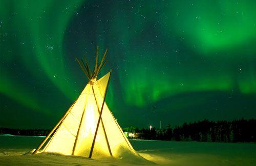 Northern Lights and illuminated Teepee in Yellowknife, Northwest Territories