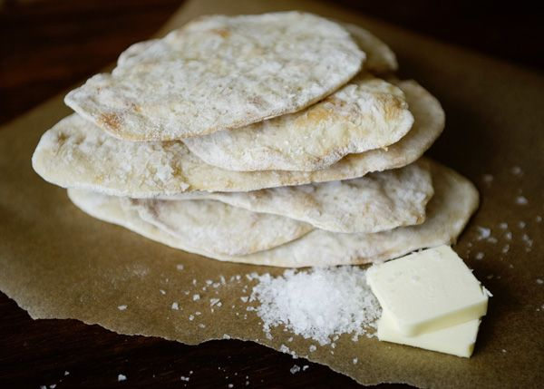 """Homemade Matzo recipe. Pinned said  -""""Was it worth making homemade matzo?  Wholeheartedly, yes.  Not only do I like a challenge, it really does taste better.  It reminds me of a very thin and crispy pizza crust.  I used some unsalted butter and a sprinkle of Maldon sea salt.  It was better than I remembered. #matzo #Passover #holiday"""""""