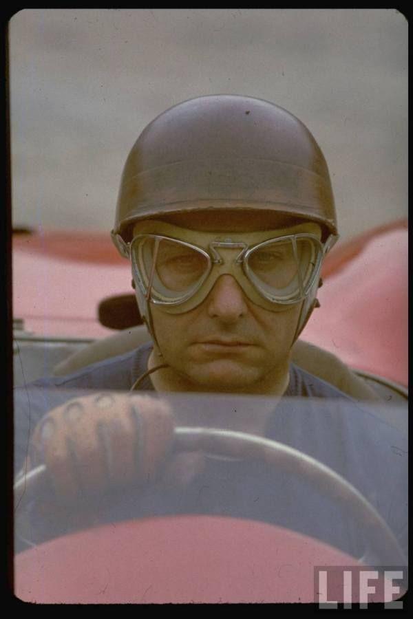 Argentine auto racing legend Juan Manuel Fangio sitting at wheel of race car at Le Mans -- 1967.