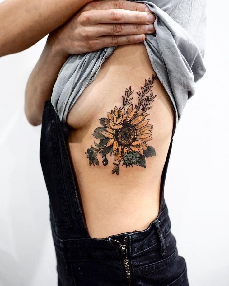 Sunflower, douglas fir, cornflower & huckleberry by Sophia Baughan #sunflower #tattoo #sophiabaughan