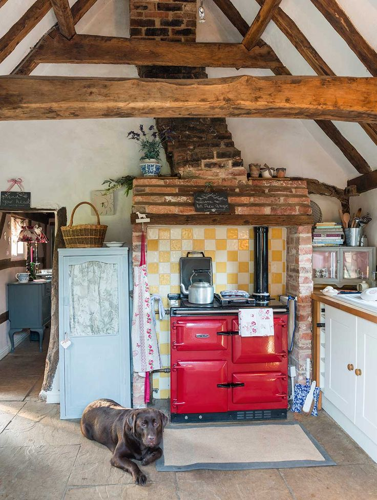 An mud and stud thatched cottage, built in the 1800s, has been refreshed with a new, soft interior scheme