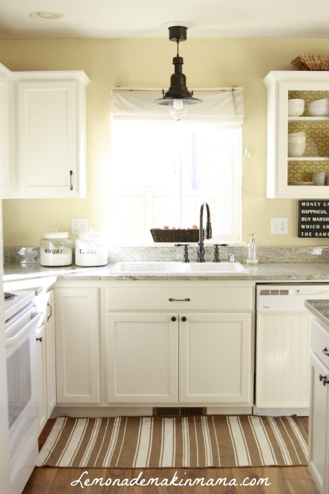 light grey counters with white cabinets and yellowish walls. LOVE.