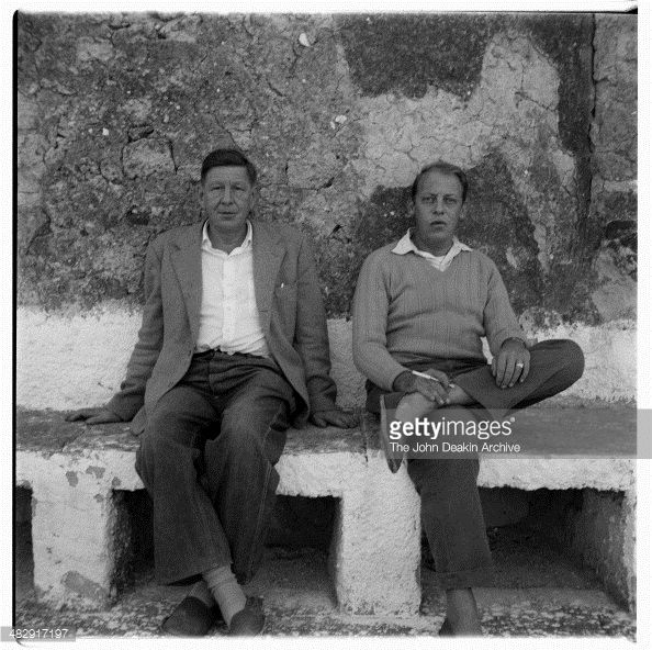 Portrait of poet W H Auden and his partner Chester Kallman at home on.