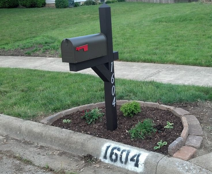 mailbox landscaping - used the paver edging design found here:  http://www.infobarrel.com/Edging_a_Flower_Bed_With_Cement_Pavers ; One year later: I recommend adding upright bricks along the curb to help hold in the mulch. Also, a spiked finial of some kind will keep the birds from messing on the upright post!
