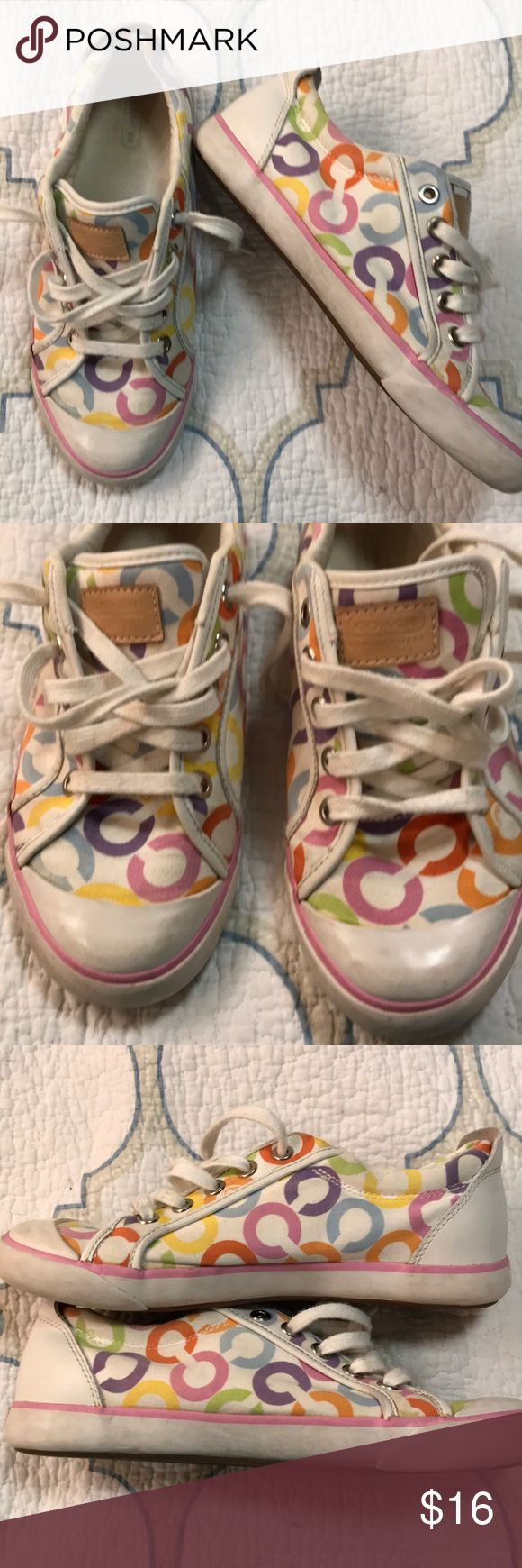 Coach Shoes These are a size 7 white coach shoes with multi color coach C's on them. They are a little dirty and could be cleaned up a little around the white sole part( shown in pics above) the left shoe has a part where it looks like some of the glue may have colored the shoe or could be a stain I can't really tell. (Shown in pic above) the right shoe has silver market on the heel. These could use to be washed. But the soles are in good condition and have so much more love to give!!! Coach…