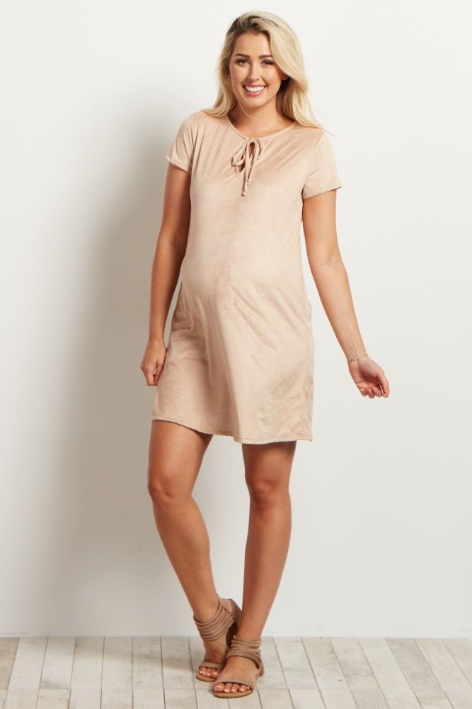 With this super soft faux suede material, you will never want to take this maternity dress off! This dress is perfect to wear in warm weather with shorts sleeves and features a chic tie front detail for a feminine look. Dress it up with a necklace and booties for a complete ensemble.
