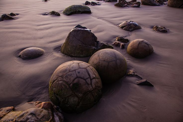 OUTDOOR SCENES – Giant Marbles: Like ancient giant marbles, the Moeraki Boulders are strewn across Koekohe Beach on New Zealand's South Island. The light of sunrise casts an other worldly hue on these rock formations. (Marcus Haid/National Geographic Traveler Photo Contest) #