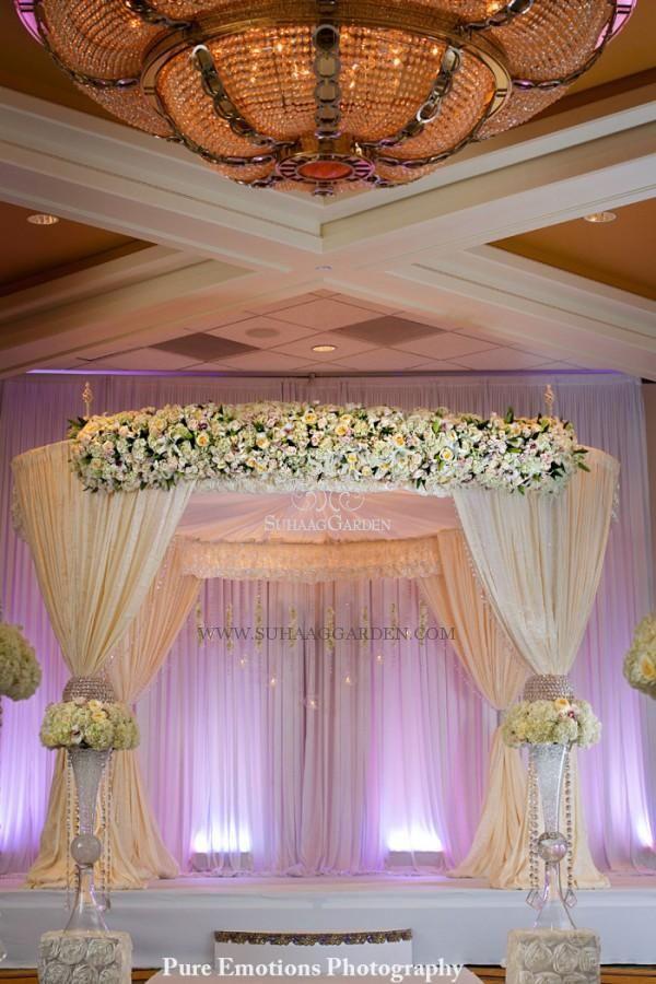 Suhaag Garden, Indian Wedding decorator, Florida wedding decorator, Mandap, white mandap, flowers, chandelier