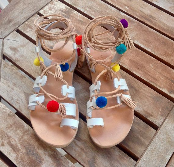 Favlos sandals The best sandals for boho style with minimal touch . Leather sandals with leather tassel and Pom Pom .