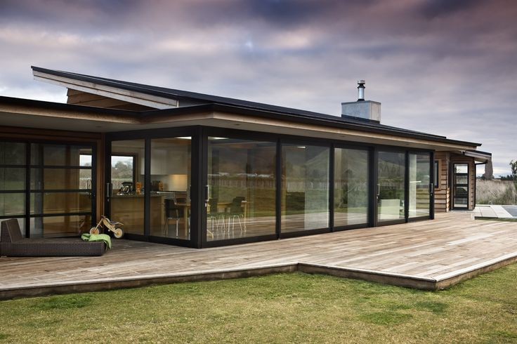 Great windows and how this house is not just a boring square box. It potentially has outdoor areas within the separate parts of the house which would be wind/weather proof.