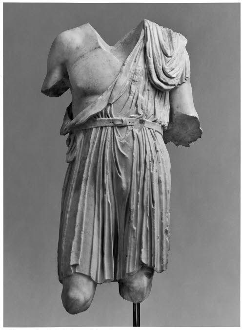 """The exomis (Ancient Greek: ἐξωμίς from exo """"outside"""", and omos """"shoulder"""") was a Greek tunic used by workers and light infantry. The tunic largely replaced the older chitoniskos (or short chiton) as the main tunic of the hoplites during the later 5th century BCE. It was made of two rectangles of linen (other materials were also used), which were stitched together from the sides to form a cylinder, leaving enough space at the top for the arms."""