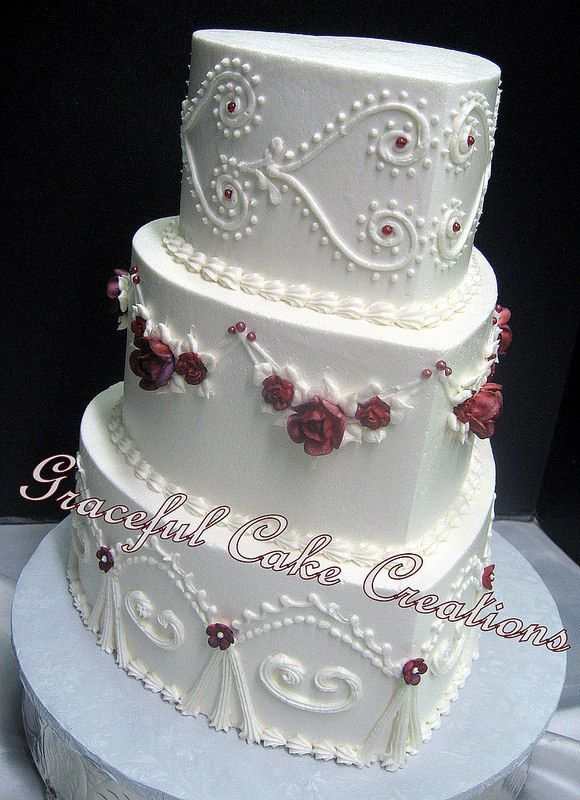 Heart Shaped Vintage Ivory Butter Cream Wedding Cake with Burgundy Sugar Paste Roses