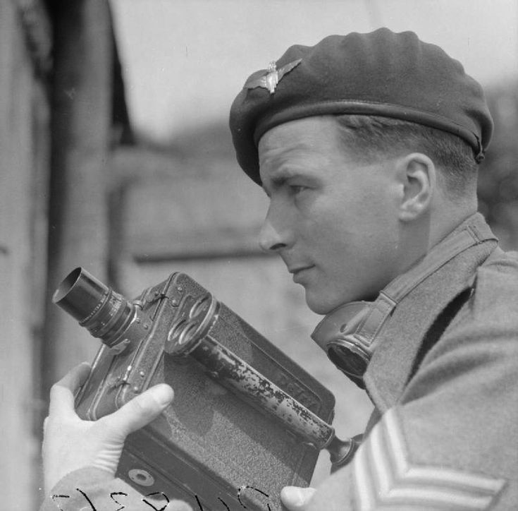 Sgt Harry Oakes, WWII cine cameraman and photographer with No 5 Army Film and Photographic Unit, poses with his cine camera for a final picture before leaving the North West European theatre in June 1945.
