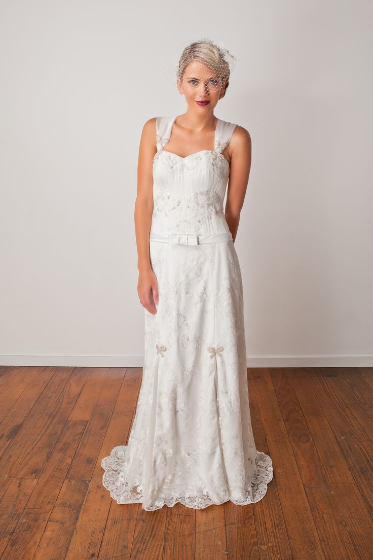 'Tallulah' Modern vintage lovers this gown is for you. Soft a-line silhouette in lace with silver highlights. Hand beaded with crystals and glass beads.