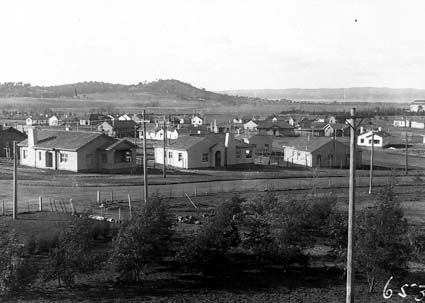 Title : FCC cottages in Kingston. Kingston Power Station on right. Mt.Pleasant on horizon Date : 1927 Primary subject : Not Assigned Secondary subject : Not Assigned Image no. : A3560, 6530 Barcode : 3197577 Location : Canberra Find other items in this series : A3560 Series accession number : A3560
