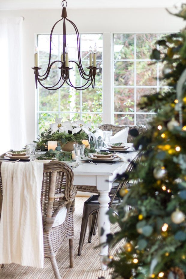 A christmas table setting all ready for the season neutral color tones and farmhouse cottage style decor