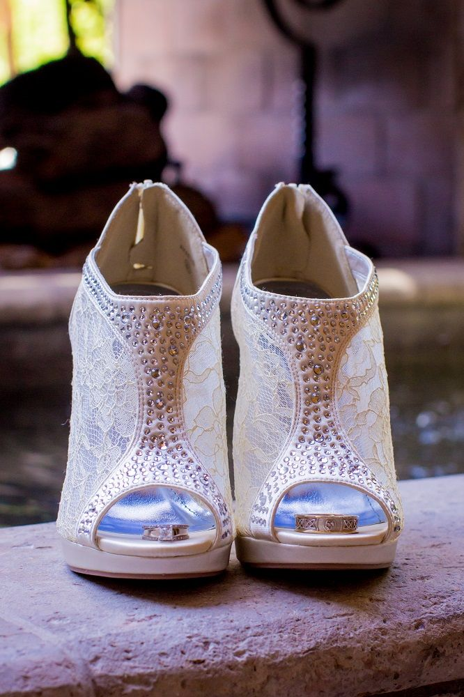 Cream Colored Bridal Shoes With A Peeptoe Encorporating Lace Rhinestones