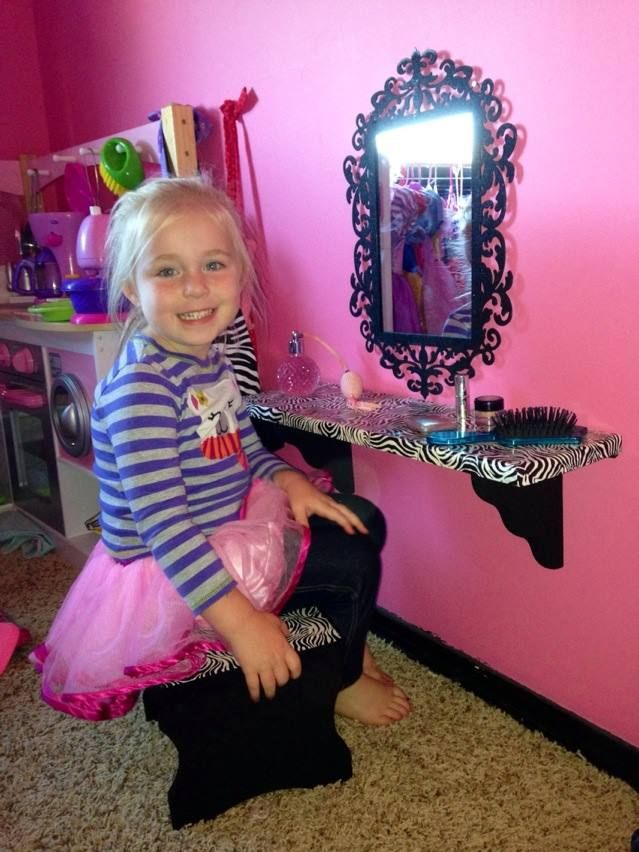 I made a vanity with a $10 stool and shelf from hobby lobby. Painted them, put zebra tape on the top to match her room and added a mirror. :)