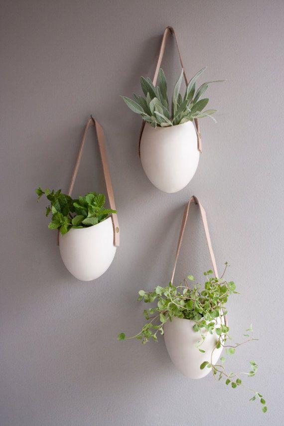 Etsy の Porcelain leather hanging planter by lightandladder