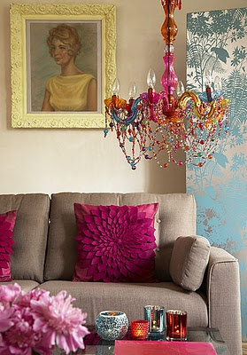 Love the chandelier and the pillow... Unlove the drab couch and the painting of the yellow lady.