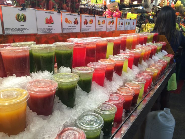 Rainbow of smoothies in a #Barcelona #Market. www.fastcover.com.au