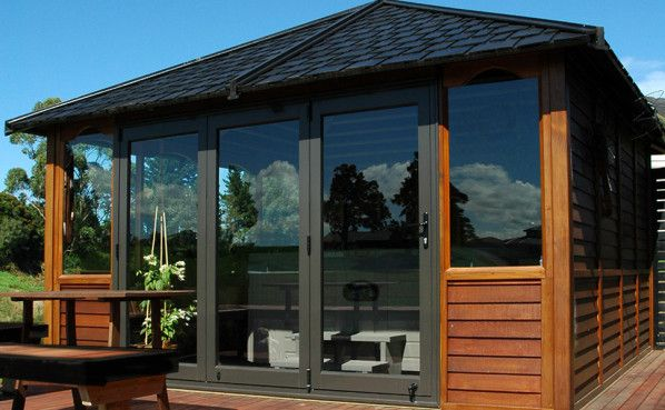 Spa cabin with bi-fold doors and dark stained timber