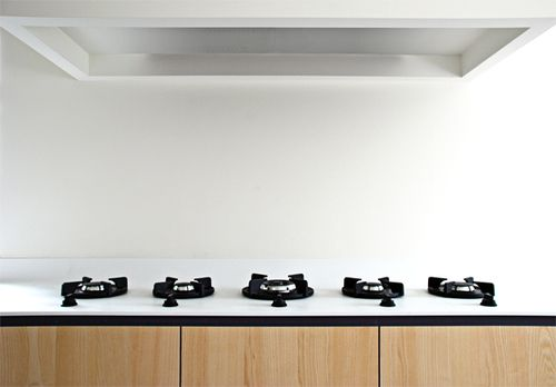 Pitt Cooking gas burners mouted directly on a HI-MACS kitchen top by Dutch architects NOMAA|architectuur & interieur.