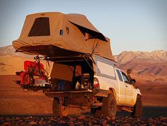 AT Overland Equipment have unveiled the all new Tacoma Habitat truck topper, a lightweight aluminum shell with robust gas springs that allow it to easily open revealing a full stand up room in the bed of the truck. With room for two adults, the shell
