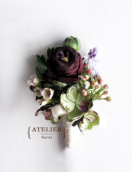 Fall-inspired boutonniere   Burgundy ranuncluses, hydrangeas, waxflowers