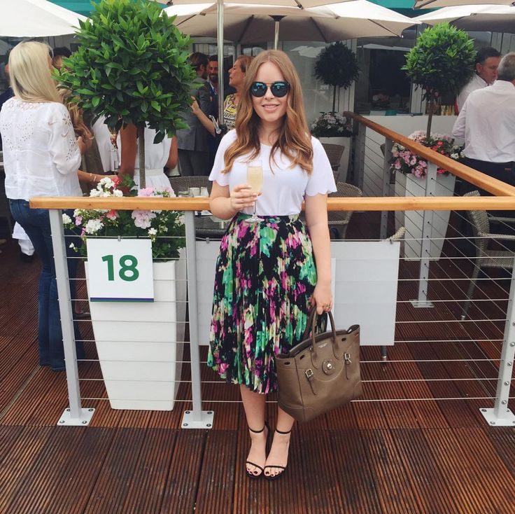 Tanya Burr in Henri Bendel sunglasses, Topshop T-shirt, Whistles skirt, YSL shoes and Ralph Lauren bag.