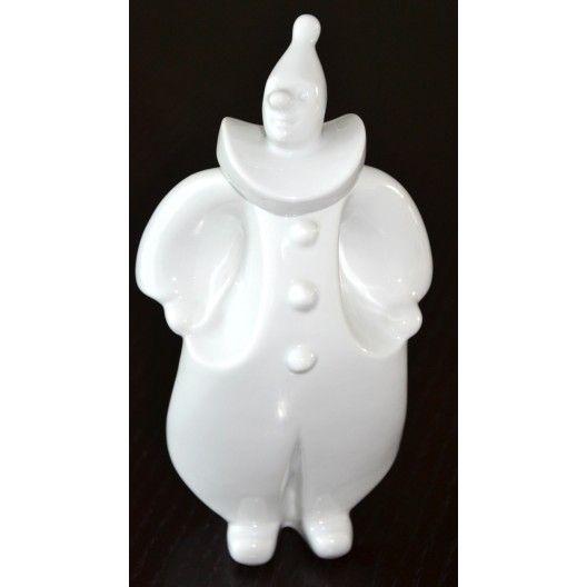 Bardzo ładna kolekcjonerska duża figurka klauna. Wyrób bez sygnatury prawdopodobnie jednej z węgierskich wytwórni porcelany. Interesująca forma, biała kolorystyka, niepospolity design . Dekoracyjny wys.25cm szer 14cm w bardzo dobrym stanie.