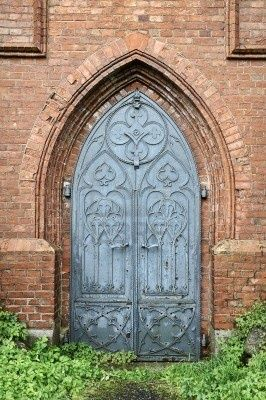 Picture Of Old Gothic Church Metal Door Red Brick Arch Stock Photo Images And Photography