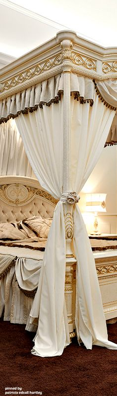 Opulent ivory bed, canopy. Neo-classical ornamentation in antique gold. Bedding and draperies for this style available DesignNashville.com  custom designs are free of charge using any of our featured fabrics.