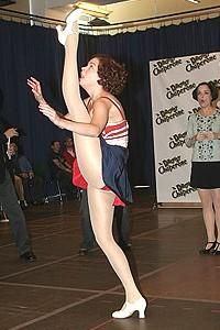Kicking goals. Sutton Foster. (lady's face in the background is priceless)