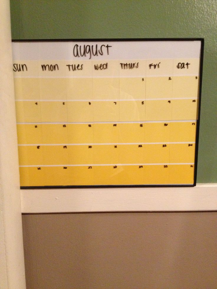 DIY Paint sample calendar I made for my dorm room with a 11x14 picture frame from Walmart and paint sample strips from lowes! Super easy, cheap, and cute!! :)