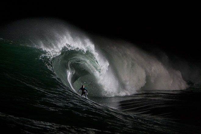 Stephanie Gilmore surfing by night